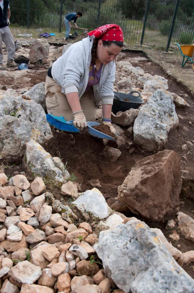 Aida Loy excavating