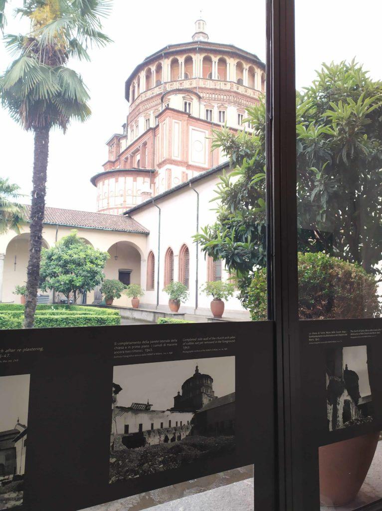 The exhibition: the Chiostro dei Morti with the church of Santa Maria delle Grazie