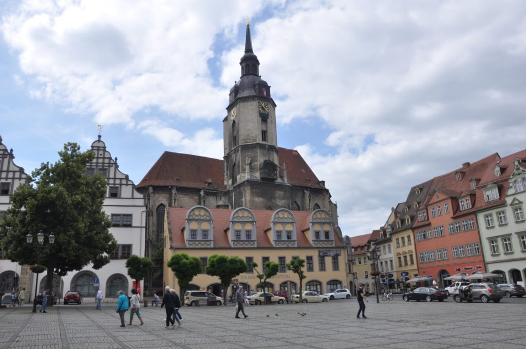 The St Wenzel clock tower casts its shadow on the Naumburg main square