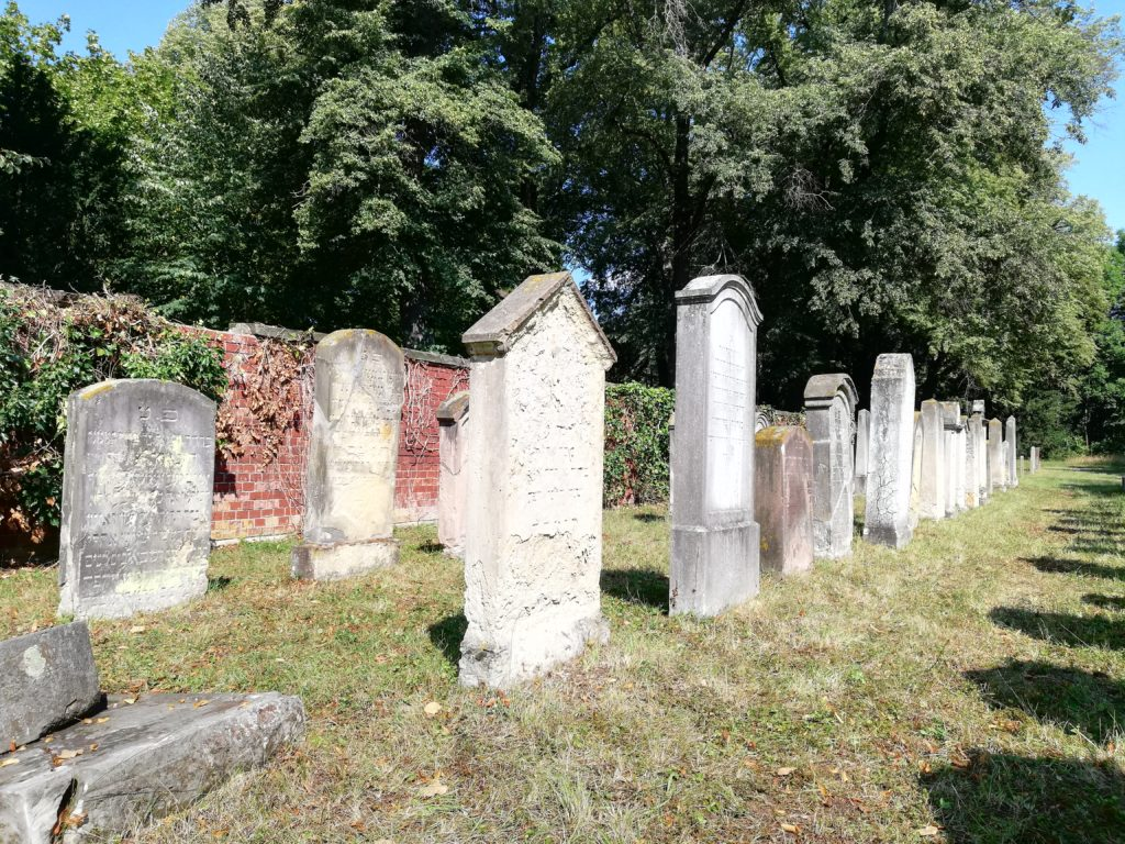 The image shows a view of the Jewish cemetery