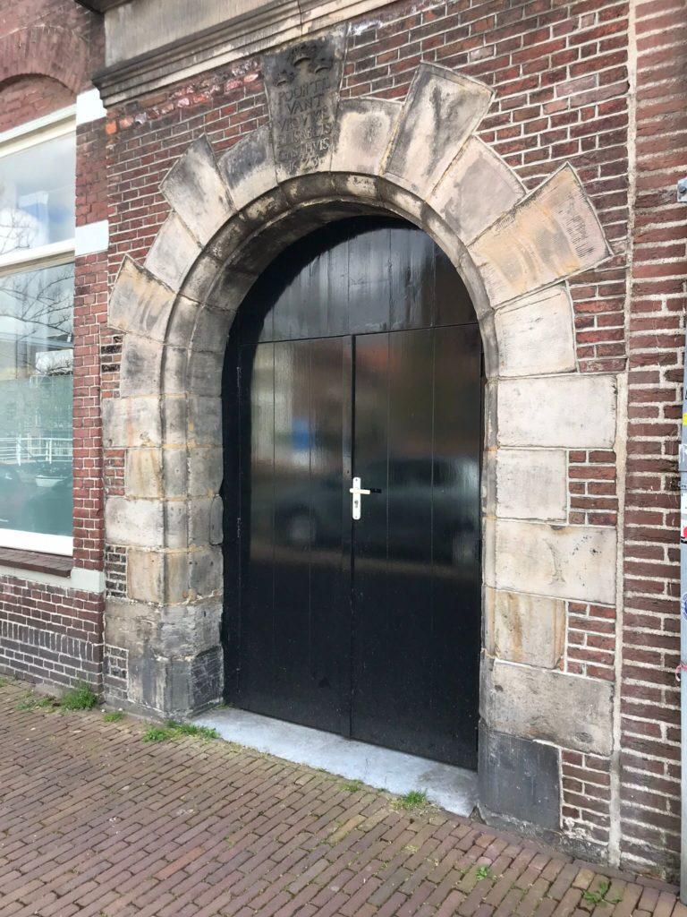 Door with inscription on top