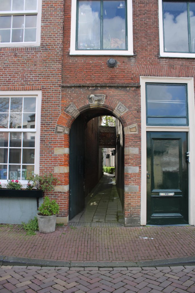 Door with decoration on top